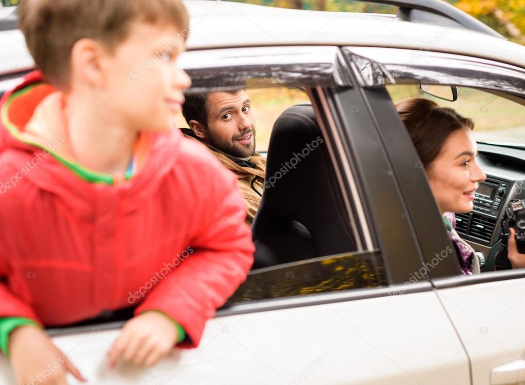 Smiling boy looking through car window