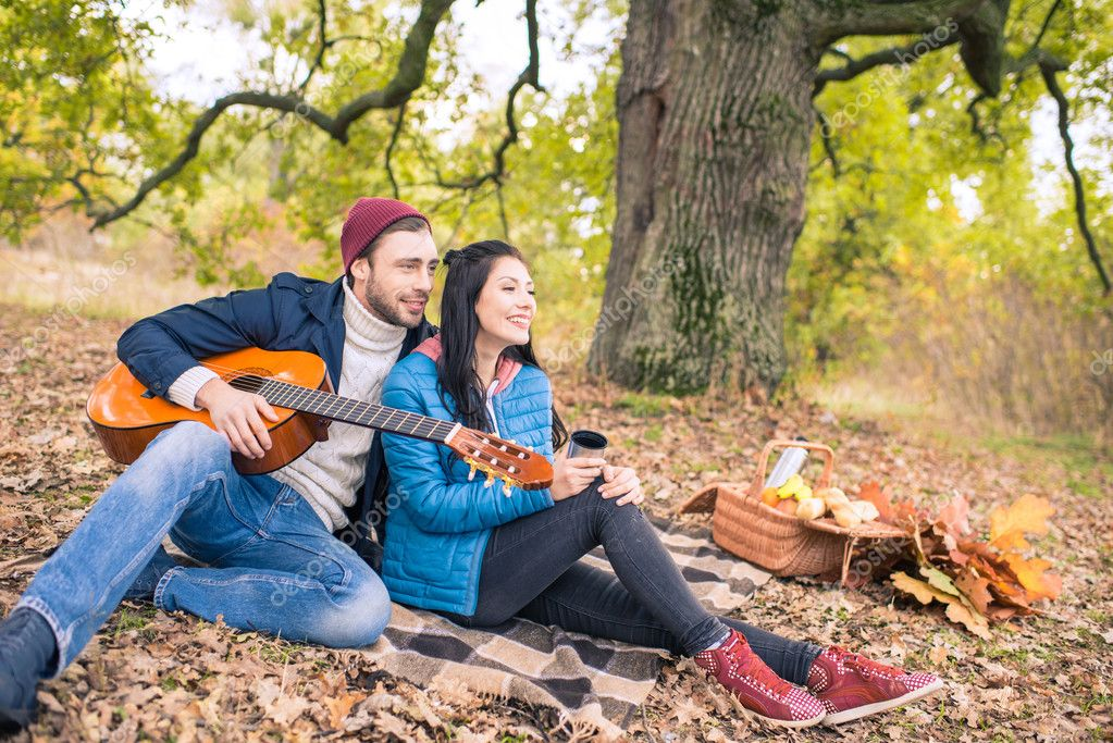 Romantic couple in autumn forest