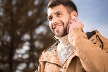 Handsome young man in earphones