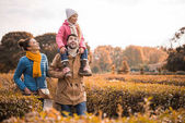 Fotografie Happy family walking in park