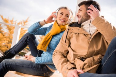 Cheerful young couple in headphones