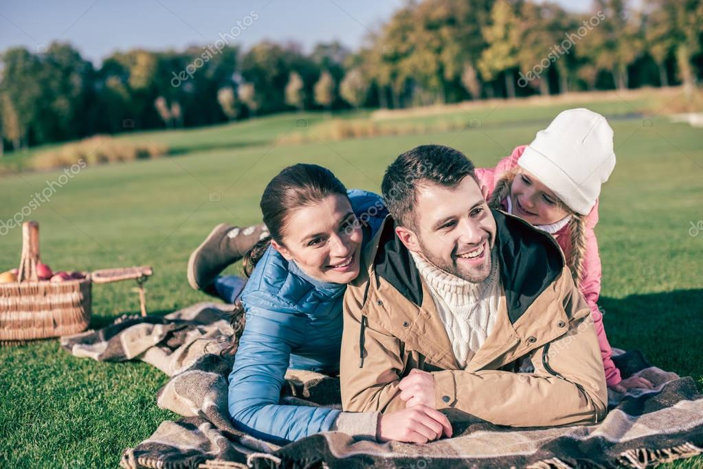 Happy family hugging and having fun