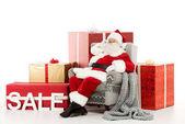 Weihnachtsmann mit Verkaufsschild