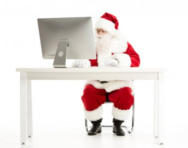 Serious Santa Claus looking at computer