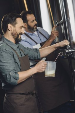 Brewery worker pouring beer