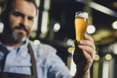 Brewery worker with glass of beer