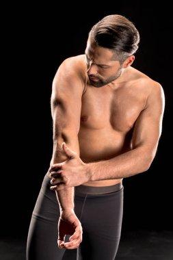 Muscular shirtless sportsman