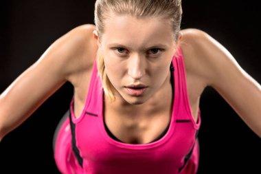 Young sportswoman doing push ups