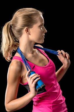 Sportswoman with skipping rope on neck