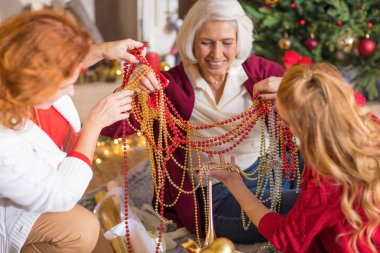 Family having fun with christmas decorations