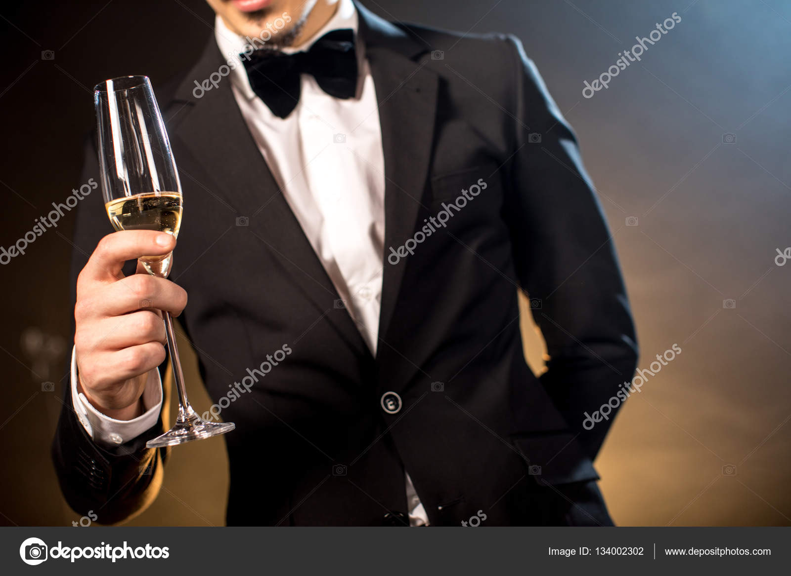 Man Holding Champagne Glass Stock Photo