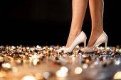 Fotografie Ženské nohy v botách na vysokém podpatku