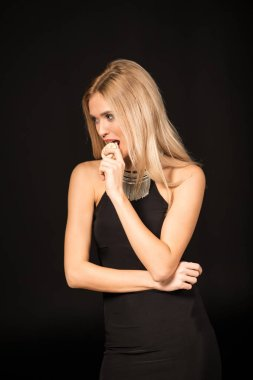 Beautiful woman eating macaroon
