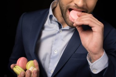 Young man with macaron