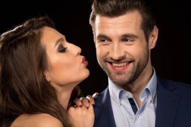 Woman kissing a man