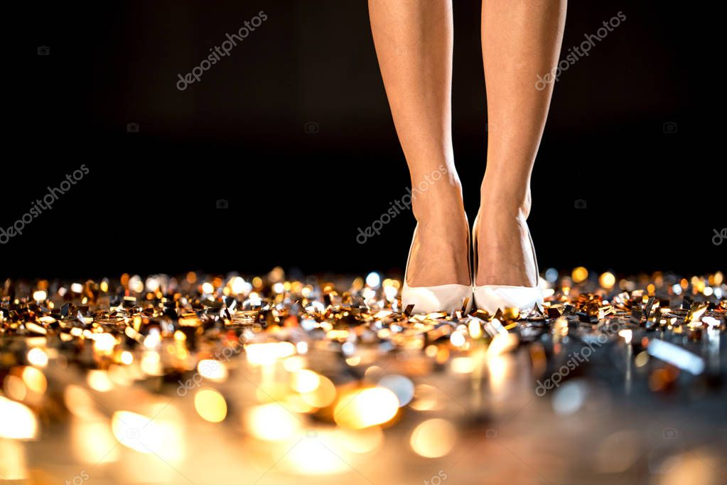 Female legs in high-heeled shoes