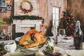 Photo Roasted turkey on holiday table