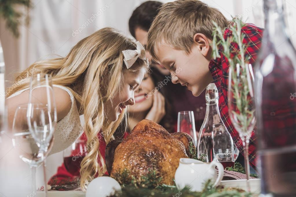 Happy siblings at holiday table