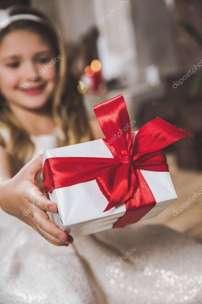Girl holding gift box