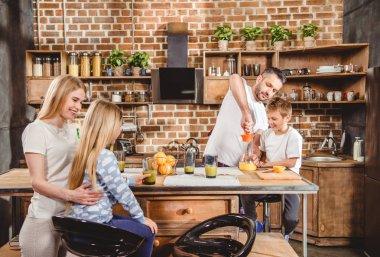 Family makes orange juice