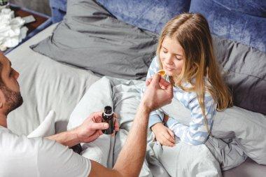 Little girl takes medicine