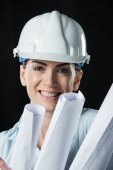 Photo Female architect in helmet