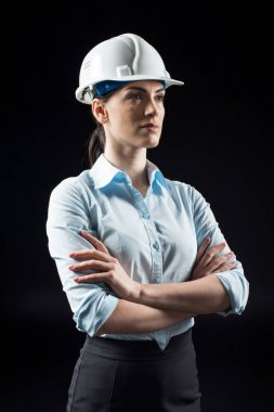 Female architect in helmet