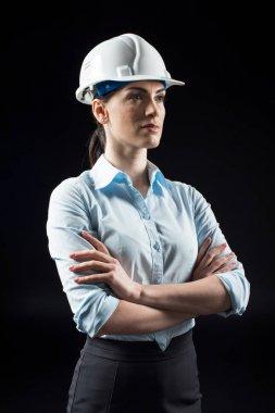 Female architect in helmet
