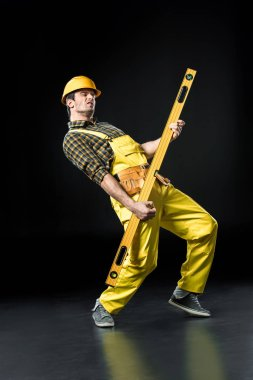 Construction worker with level tool
