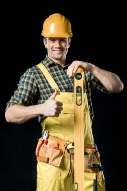 Worker with level tool