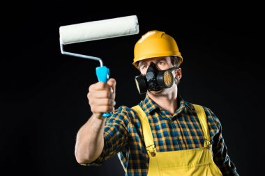 Worker with paint roller