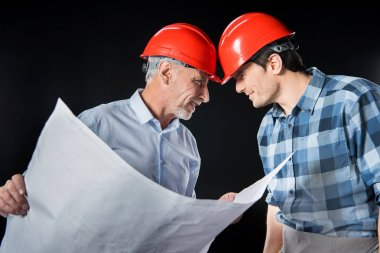 Engineer and architect in hard hats