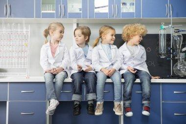 Schoolchildren sitting in laboratory