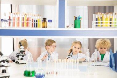 Schoolchildren studying in laboratory