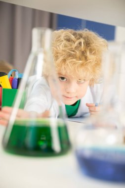Schoolboy studying in laboratory