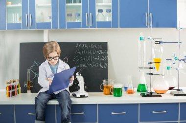 Boy in science laboratory