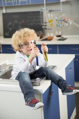 Boy sitting in sink
