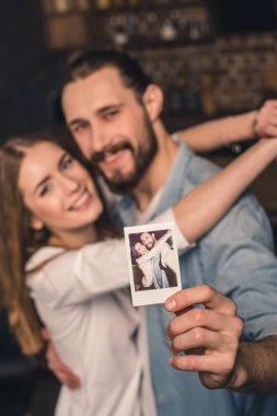 Couple with instant photo