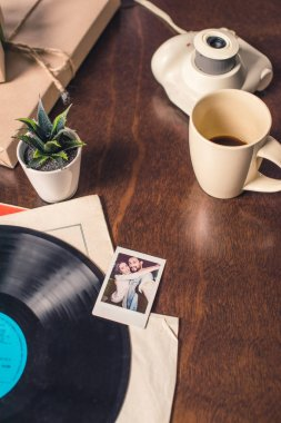 Vynil record and instant photo