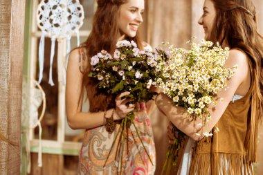 Bohemian women holding flowers