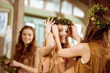 Bohemian women wearing floral wreaths
