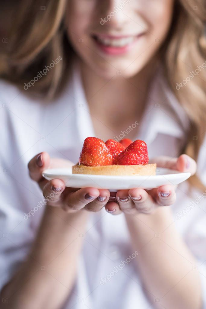 Woman with strawberry cake