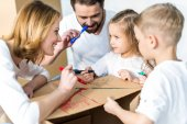 Fotografie Family drawing on cardboard box