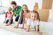 Fotografie Rodinný rozvinutí koberec