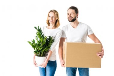 Couple holding box and plant