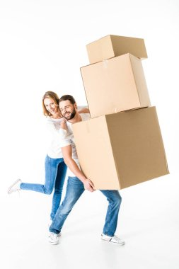 Smiling young couple having fun with cardboard boxes  isolated on white stock vector