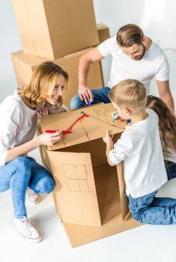 Family drawing on cardboard box
