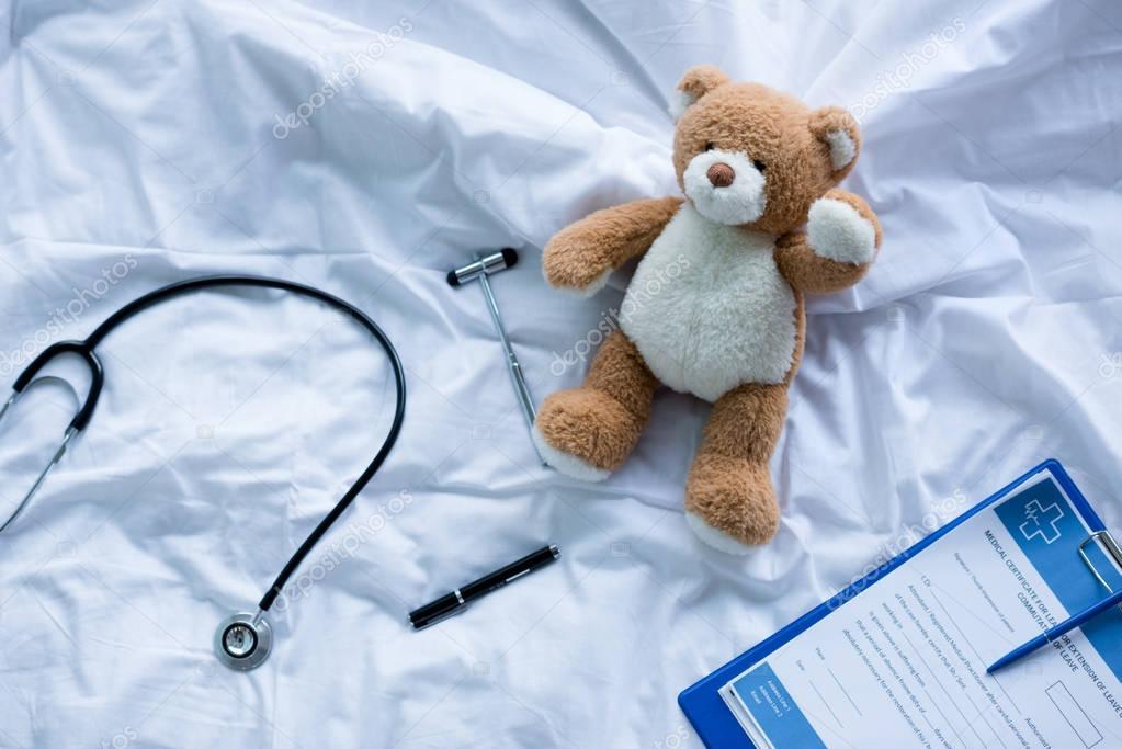 Medical tools and teddy bear