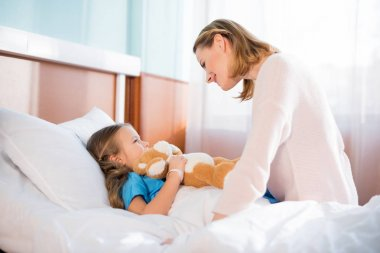 Woman with daughter in hospital