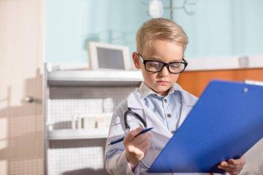 Little boy pretending to be doctor